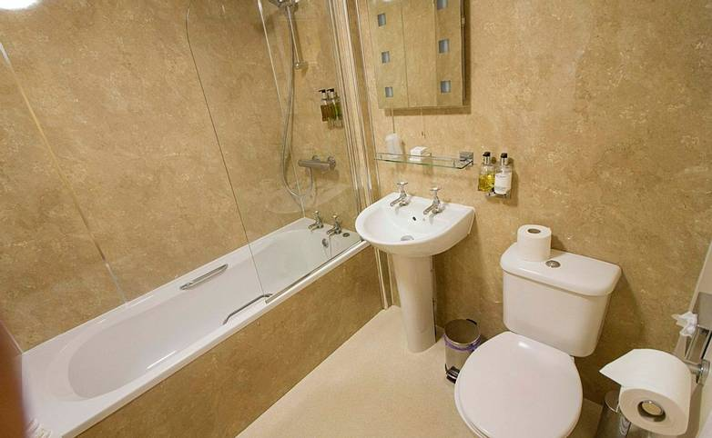 Bathroom Twice Brewed Inn from hotel's website.jpg