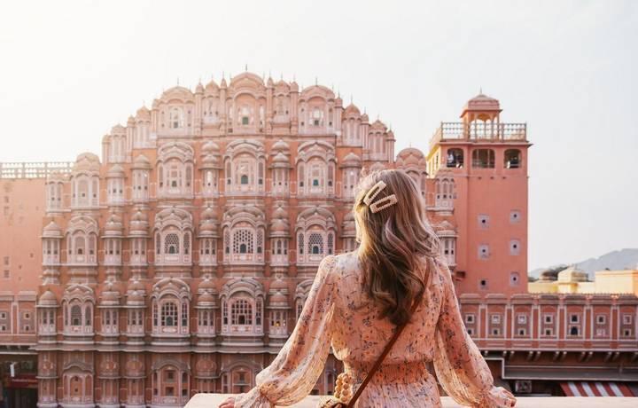 beautiful asian female sightseeing and sunset over Hawa mahal at pink city Jaipur Rajasthan india