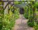 View along the rose arbour from the kitchen door