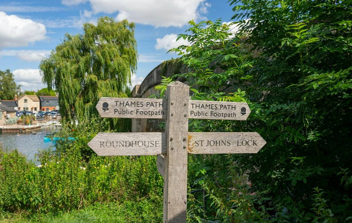 Thames Path signpost by Halfpenny Bridge, Lechlade, Gloucestershire, United Kingdom