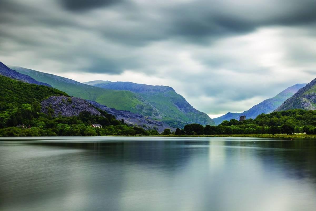 Llanberis, Gwynedd, northwest Wales, lake Llyn Padarn at the foot of Snowdon and Dolbararn Castle.