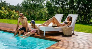 Family relaxing by pool