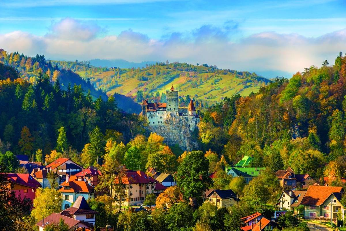 Panoramic view over Dracula medieval Castle Bran in autumn season, the most visited tourist attraction of  Brasov, Transylva…