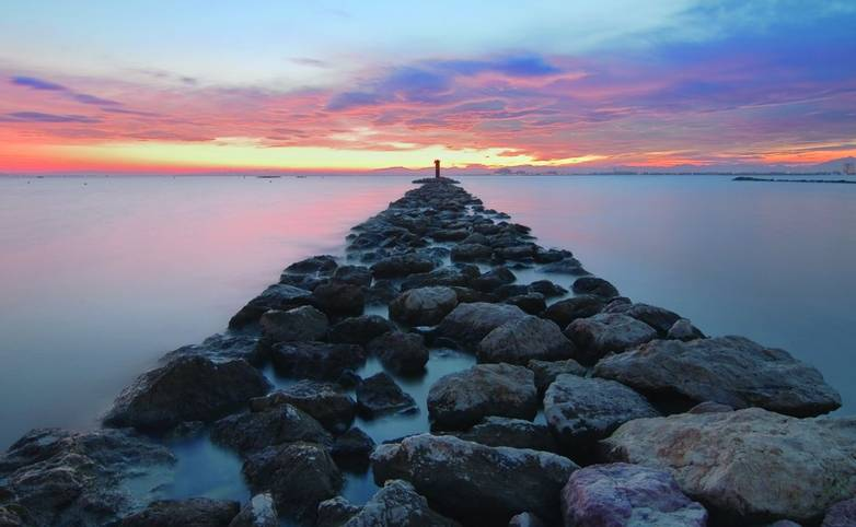 Long exposure in a breakwater of Bay of Roses, Catalonia.