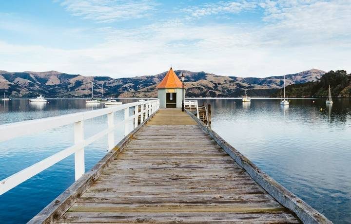 Jetty pier building on lake at Akaroa ,South Island New Zealand, Toned Image