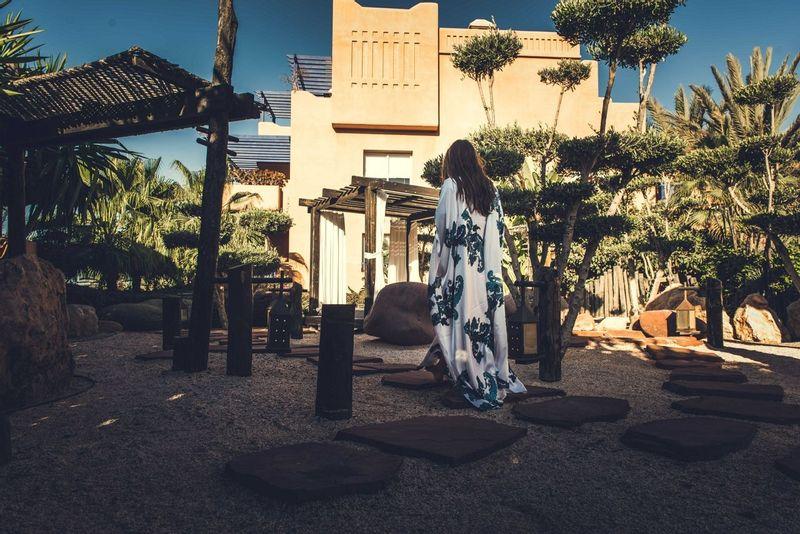 Paradis Plage resort with a woman in a kimono walking through