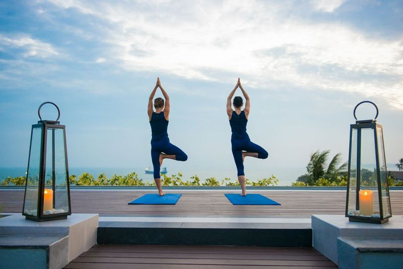 two people practicing yoga on a retreat