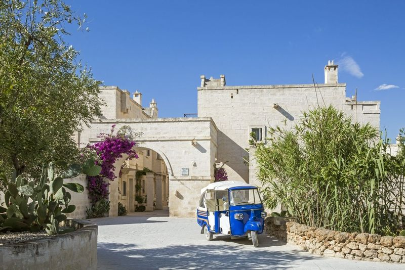 Entrance to Borgo Egnazia with a little blue tuk tuk