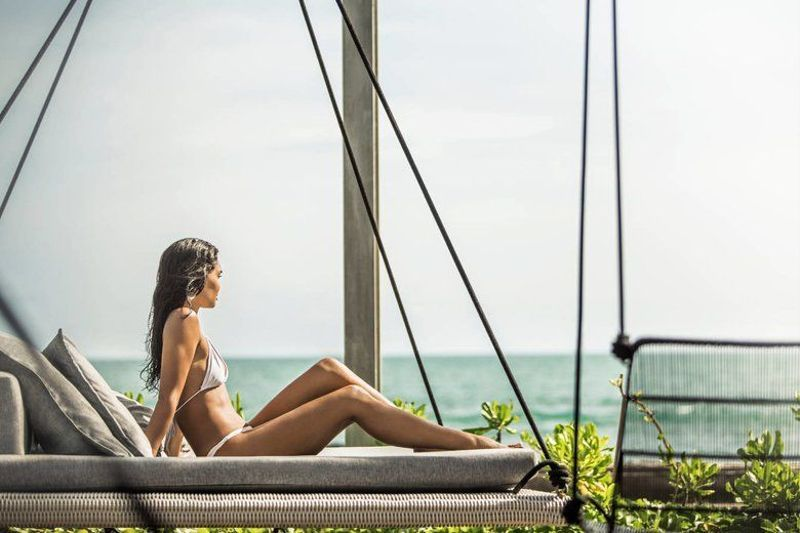 The Mental Health Benefits of Having a Holiday to Look Forward To, Women Looking out Ahead