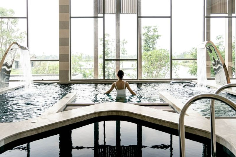 RAKxa Wellness & Medical retreat pool with women enjoying the spa facilities