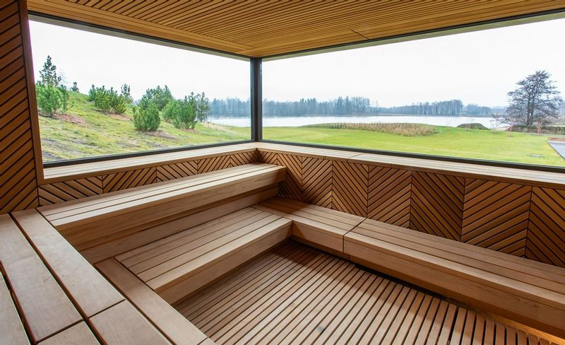 Vilnius Grand Resort's Sauna with views outside of the lake and hills