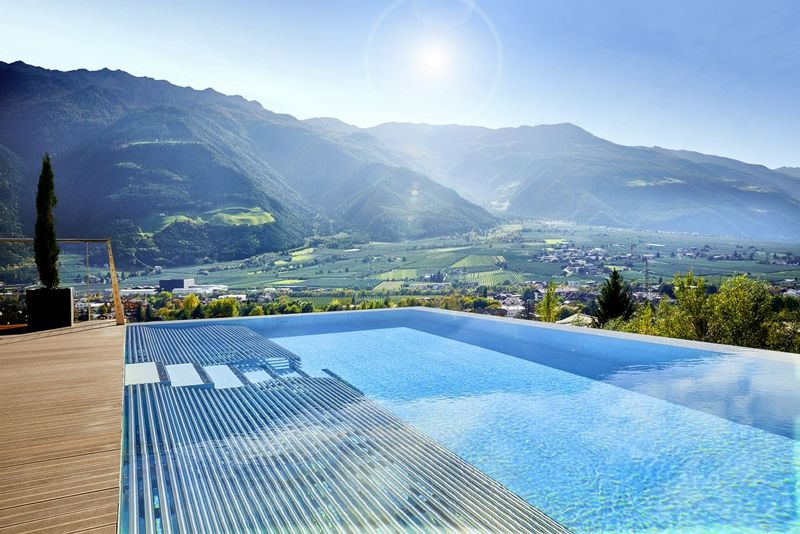 Preidlhof view with swimming pool and mountains