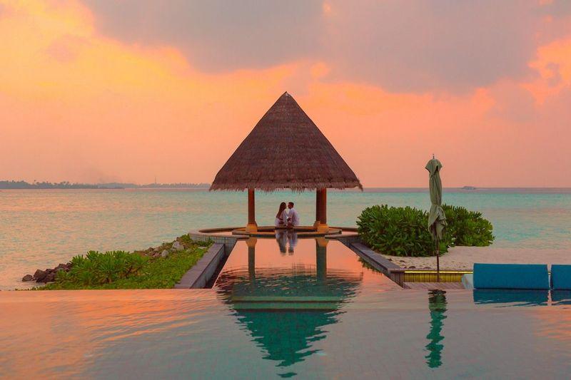 Couple under a pavilion in the Maldives