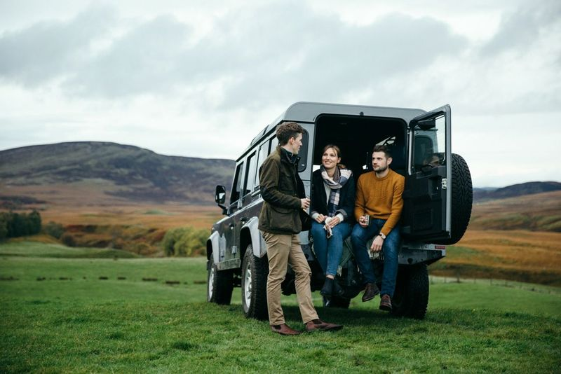 Group in a jeep, ready for a hike in Scotland